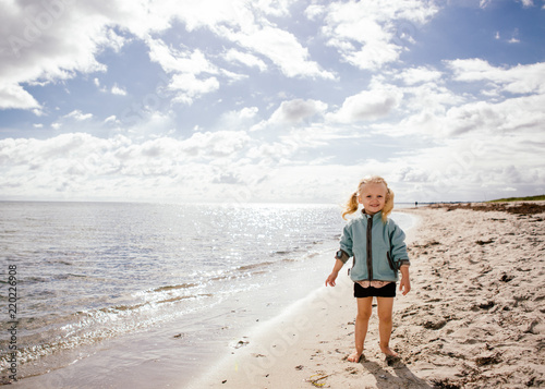 Photo  2 year old on the beach in Denmark - early fall