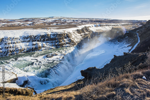 Tuinposter Cappuccino The amazing show of the Gulfoss waterfall during winter time. Gulfoss is located in the canyon of Hvítá river in southwest Iceland.