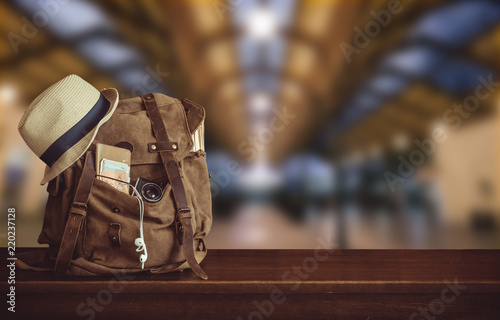 Backpack and hat at the train station . Travel concept.