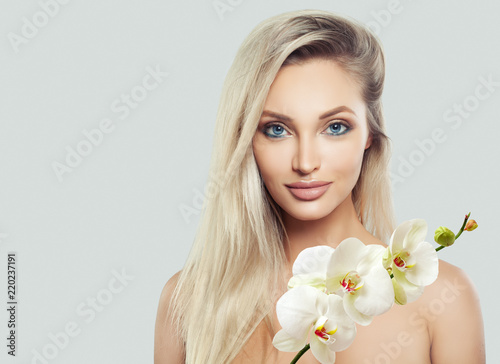 Female Face Beautiful Blonde Woman With Healthy Skin Wavy Hair And White Orchid Flowers On Banner Background Buy This Stock Photo And Explore Similar Images At Adobe Stock Adobe Stock