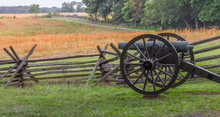 A Single Cannon At Gettysburg PA By A Split  Log Fence