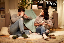 Leisure, Technology And People Concept - Happy Couple With Camera Photographing At Home