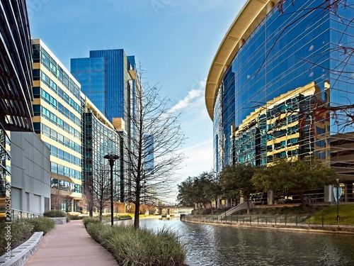 Fotografie, Obraz  Waterway with Glass Buildings in The Woodlands TX