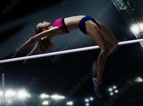 Cuadros en Lienzo The female athlete in action