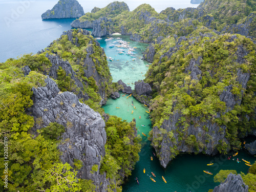 Foto op Aluminium Guilin Aerial drone view of kayaks and boats around a beautiful tropical lagoon surrounded by vertical limestone cliffs