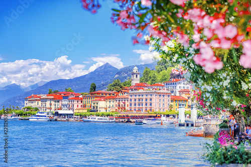 Photo sur Toile Europe du Nord Lake Como, town Bellagio, Italy. Fascinating scenery of coastal town in famous and popular luxury summer resort - lake Como. Boat ferry in the distance.