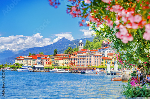 Recess Fitting Northern Europe Italy, Europe. Lake Como and lovely village Bellagio, view through pink flowers of oleander plant. Gorgeous travel background of traditional italian small towns, lake Como is popular summer resort.