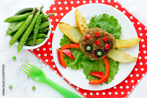 Food art idea for kids lunch - meatball with fried potato and vegetables shaped crab or spider