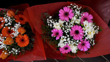 Couple Of Multicolored Gerbera Bouquets At Trade Fair, Assortment Of Flowers