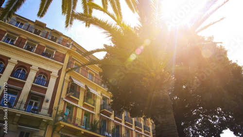 In de dag Centraal Europa Beautiful hotel building and palm trees in resort city, summer vacation travel
