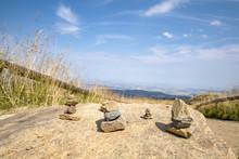 Small Pebble Stacks Balancing On A Large Rock