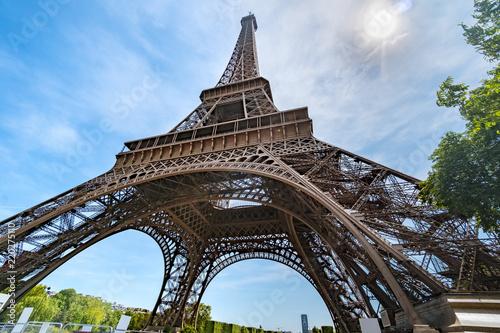 Deurstickers Eiffeltoren Post card of iconic landmark Eiffel tower in Paris against spring blue sky