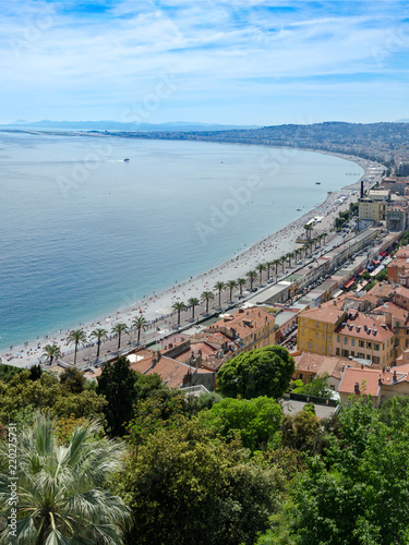 Fotobehang Nice View of city of Nice coastline and beach with blue sky and cloudscape background, France, vertical