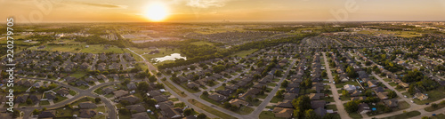 Aerial panorama of planned development and neighborhoods in Oklahoma City at sunset.