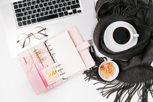 Workspace With Laptop, Notebook With Planner, Coffee Cup Wrapped In Scarf,  Glasses. Stylish Office Desk. Autumn Or Winter Concept.  Flat Lay, Top View