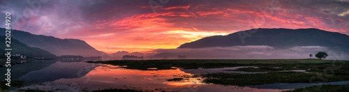 Beautiful colorful sunset over Loch Leven, Glencoe village, Scotland, UK Wallpaper Mural