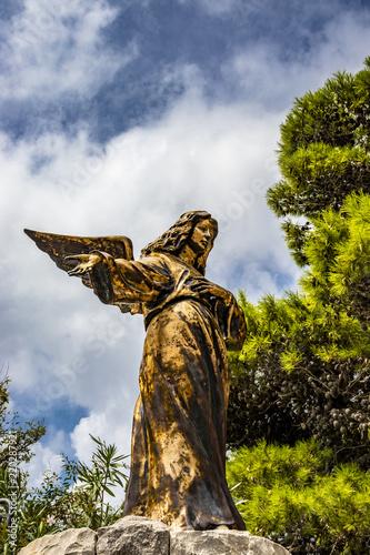 Fotografie, Obraz  A bronze statue of an angel in Santa Maria di Leuca