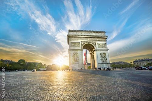 Valokuva  Paris Arc de Triomphe (Triumphal Arch) in Chaps Elysees at sunset, Paris, France