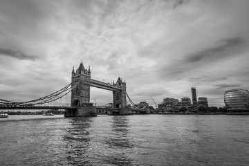 Wide-angle view of the Tower Bridge in London, UK in monochrome. Black and white photography.