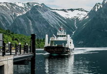Norway Ferry Boat Landing  Description:  A Boat Carrying Passengers And Vehicles Completes A Fjord Crossing Along The Coastal Route North Of Alesund, Norway.