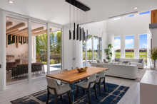 Modern Open Plan Dining Room And Lounge With Large Sliding Glass Doors
