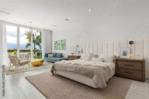 Modern Cream And White Master Bedroom With Large Sliding Glass Doors Stock Photo Adobe Stock