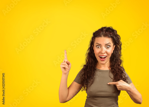 Fotografie, Obraz  Excited woman in surprise pointing at herself