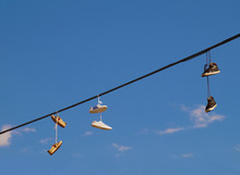 Shoes Hanging On The Wires, A ...