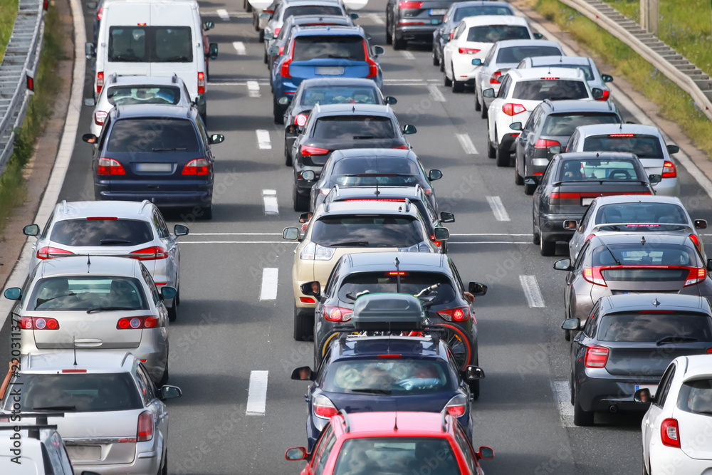 Fototapety, obrazy: Rear view of traffic jam of lined up cars
