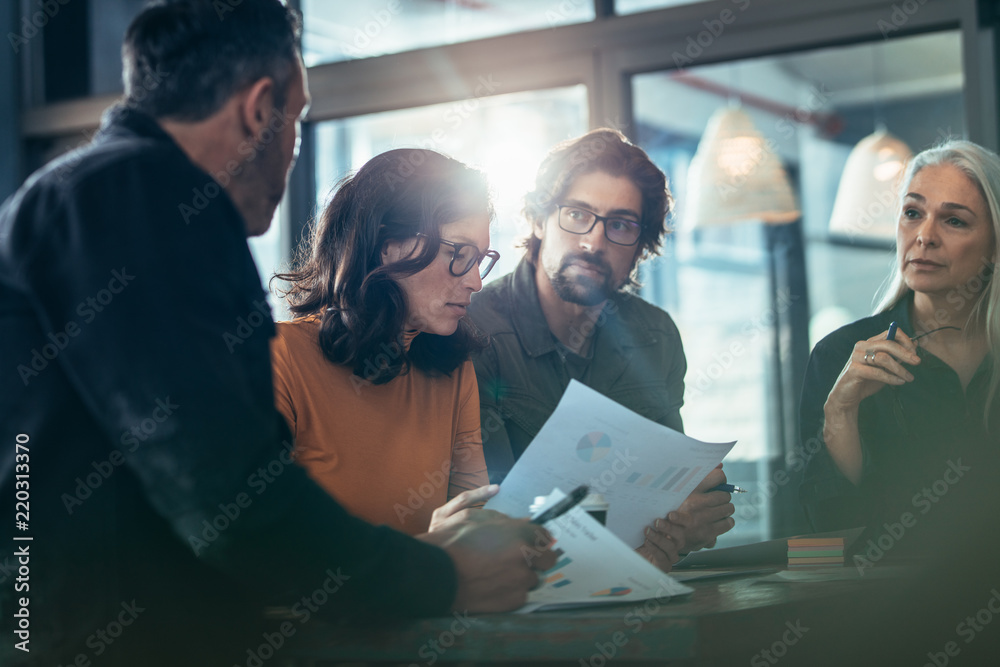 Fototapeta Team brainstorming for new business strategy