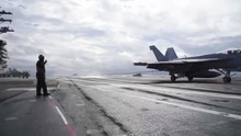 A Fighter Jet Lands On The Dec...
