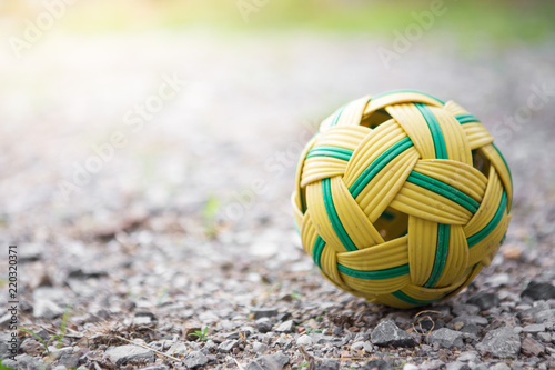 Foto  Rattan ball on the ground rubble
