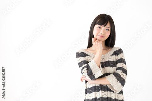 Fototapeta portrait of young asian woman thinking on white background obraz