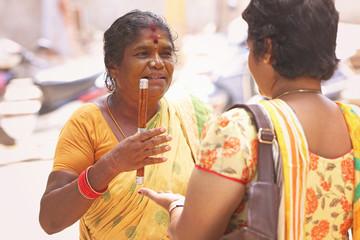 Indian female astrologer telling something to girl