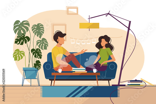 Couple of guy and girl sitting on couch at home - 220351569