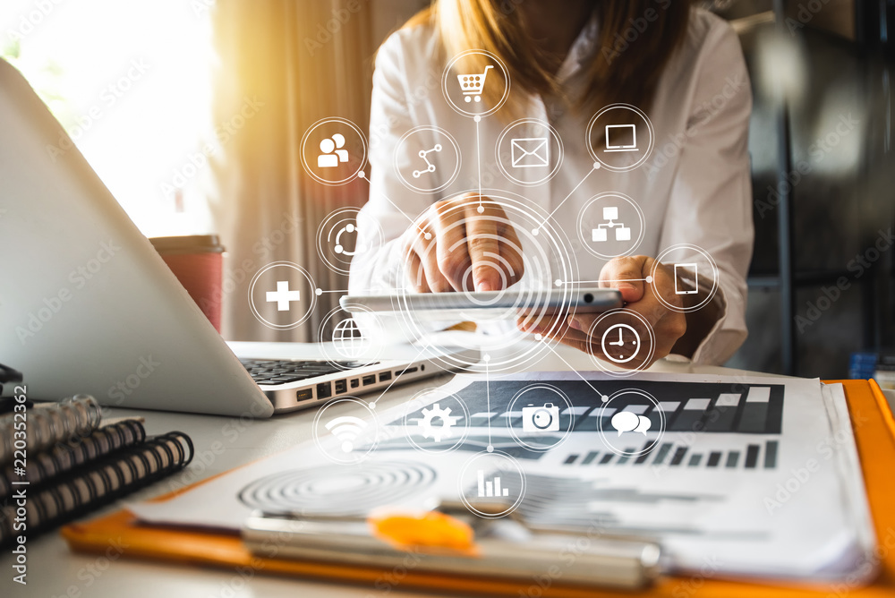 Fototapety, obrazy: Digital marketing media in virtual screen.businesswoman hand working with mobile phone and modern compute with VR icon diagram at office in morning light