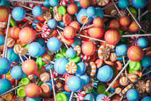 Colorful Orange Blue And Green Lollipops Backdrop