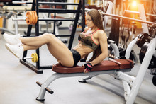 Athletic Young Woman Exercises...