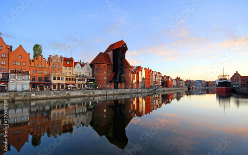 Old town of Gdansk reflected in Motlawa river at sunrise, Poland.  © zbg2