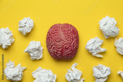 Fototapety, obrazy: Brainstorming ideas. Brain with crumpled paper on a yellow background.