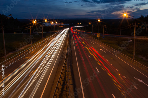 Foto op Canvas Nacht snelweg Night traffic road highway with car lights