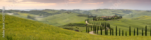Poster Landscapes Panoramic view of sunset over the Agriturismo Baccoleno and winding path with cypress trees, Asciano in Tuscany, Italy, Europe