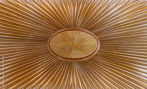 Fotografia  Decorated golden wooden ceiling with design based on the old flag of the ottoman