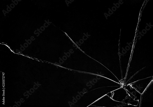 Fototapeta Shards of a broken glass on a black background, shattered pieces. Useful texture in overlay mode. Horizontal shot.  obraz