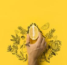 Man Holding Half Of Lemon Isol...