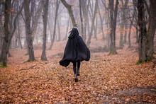 Girl In Black Hood Running Awa...