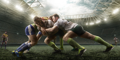 Rugby players fight for the...