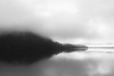Delightful landscape view of Austrian Alps. Monochromatic sunset over the early morning river covered with fog. - 220384779