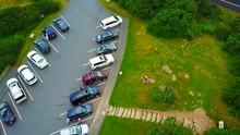 Aerial View Panning Down To Reveal A Car Park At Mount Mitchell State Park.