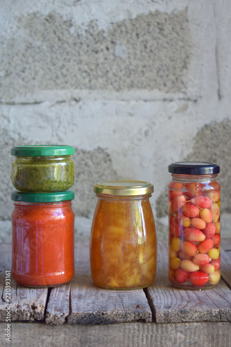 Canvas Prints Spices Variety of preserved food in glass jars - pickles, jam, marmalade, sauces, ketchup. Preserving vegetables and fruits. Fermented food. Autumn canning. Conservation of harvest.